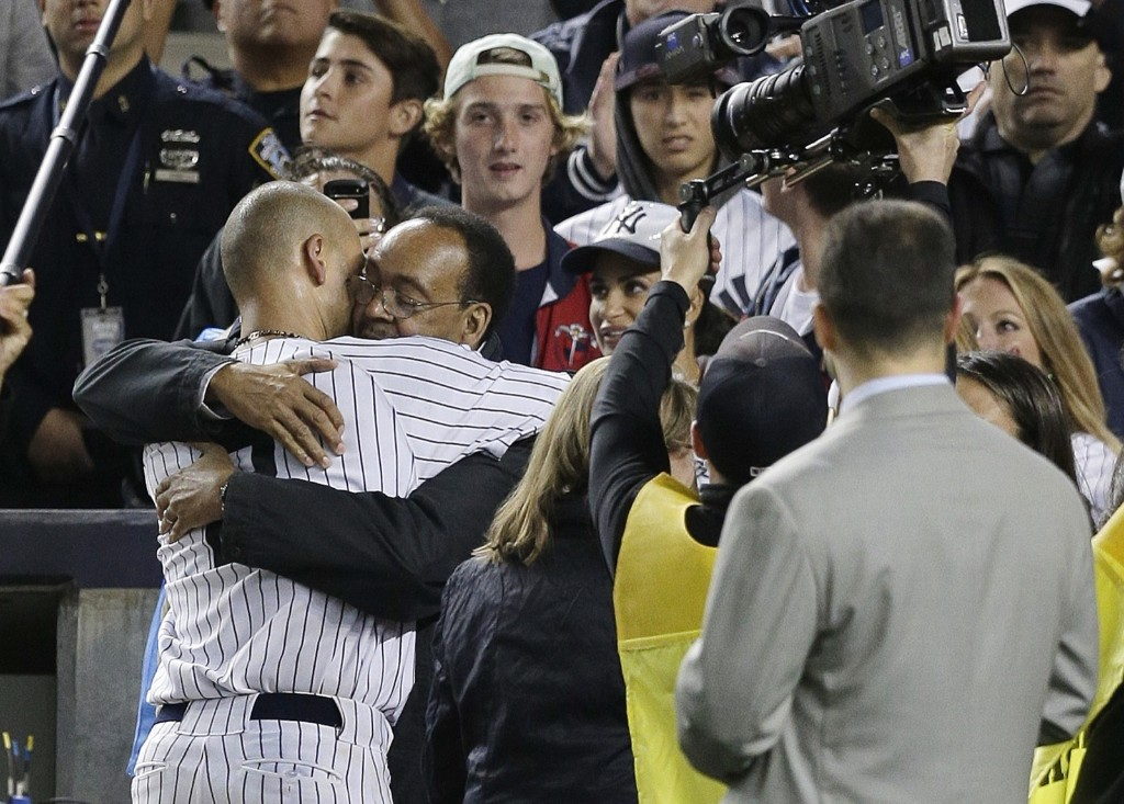 Derek Jeter hugs his father Charles after playing his last home game at Yankee Stadium. AP Photo/Julie Jacobson
