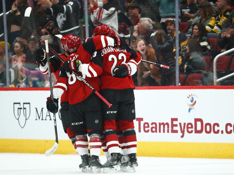 Jan 18, 2019; Glendale, AZ, USA; Arizona Coyotes center Clayton Keller (9) celebrates with teammates after scoring after a goal against the Pittsburgh Penguins in the first period at Gila River Arena. Mandatory Credit: Mark J. Rebilas-USA TODAY Sports