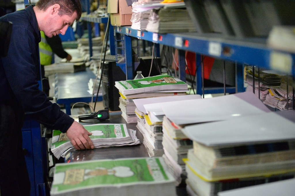 A workman prepares the new edition of Charlie Hebdo for delivery at a press distribution center in Marne-la-Vallee, France, Wednesday. Aurelien Meunier/Getty Images