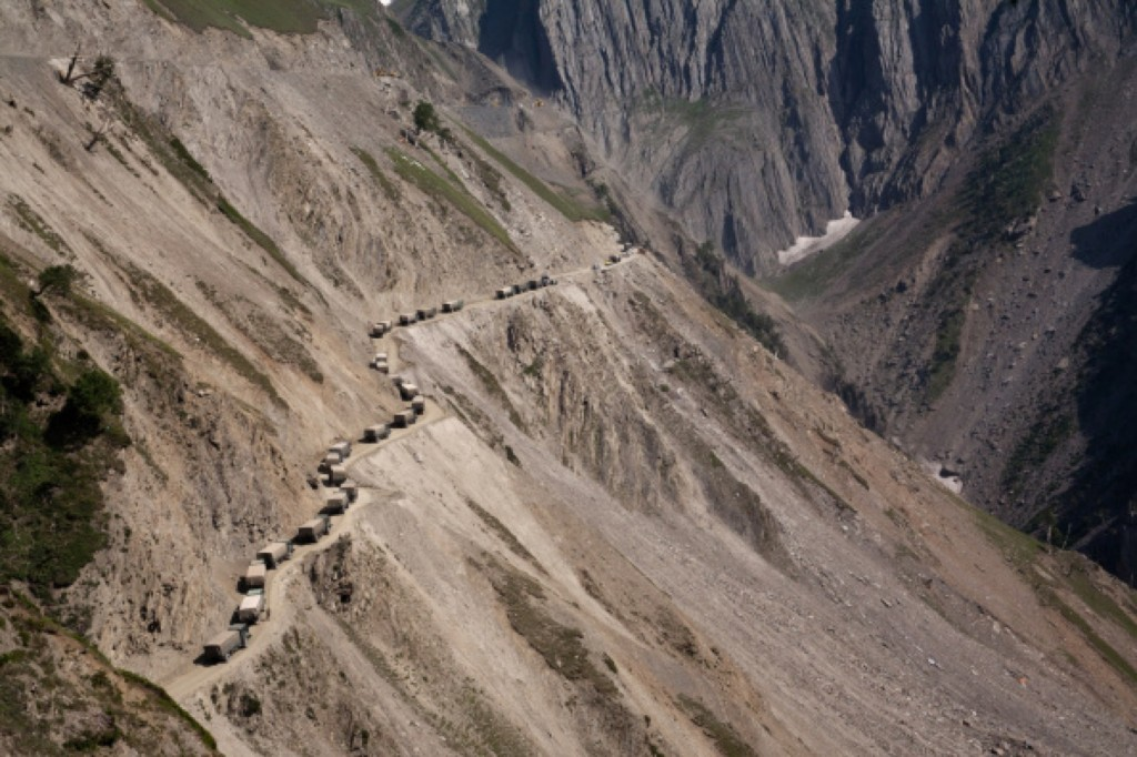 Indian army convoy carrying supplies moves on a treacherous pass in Zojila. Yawar Nazir/Getty Images