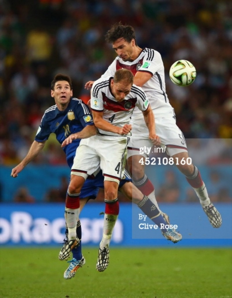 Lionel Messi of Argentina battles with Benedikt Hoewedes and Mats Hummels of Germany. Clive Rose/Getty Images