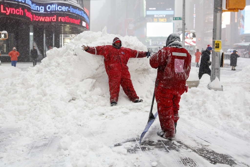 Members of the Times Square Alliance snow clearing team. REUTERS/Shannon Stapleton