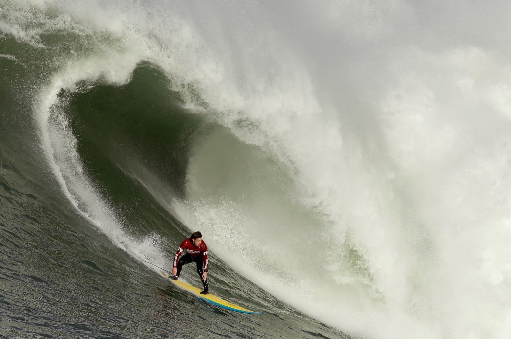 Colin Dwyer rides a wave during the second heat of round one. Ezra Shaw/Getty Images