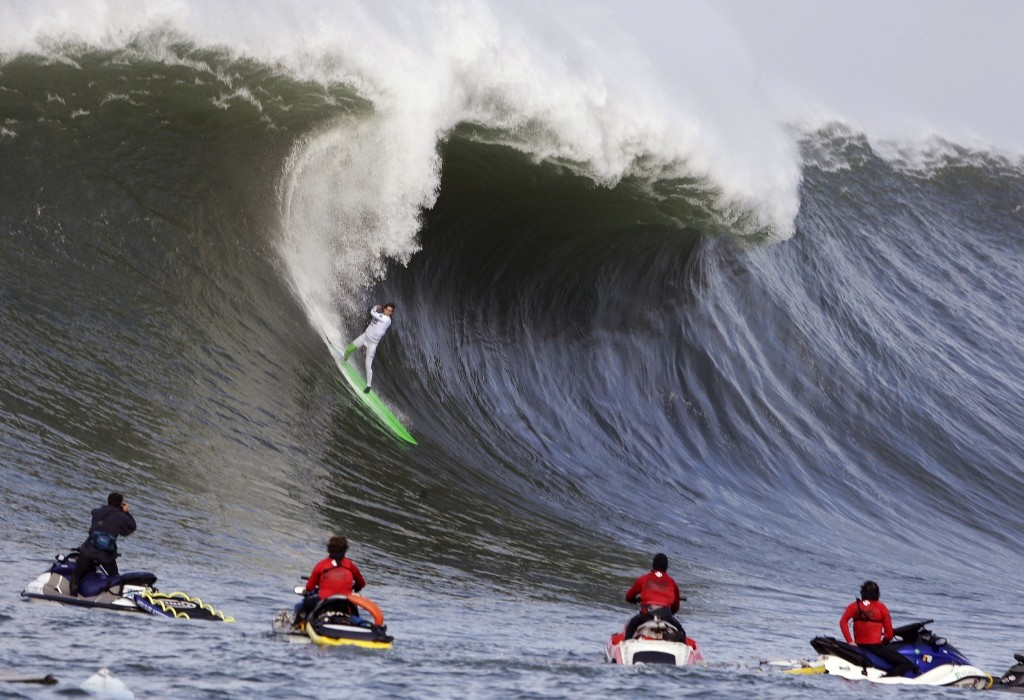 Nic Lamb rides a wave during the first round. AP Photo/Eric Risberg