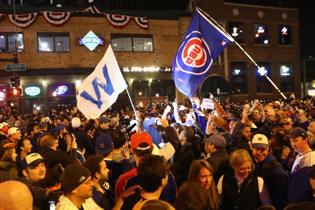 Long suffering Cub fans celebrate outside Wrigley Field. Dylan Buell/Getty Images