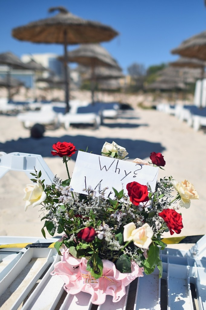 Flowers are placed at the beach next to the Imperial Marhaba Hotel where 38 people were killed in a terrorist attack in Souuse, Tunisia. Jeff J Mitchell/Getty Images