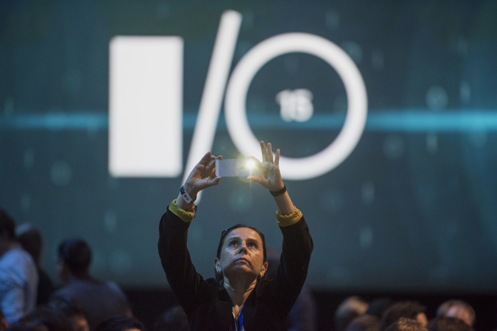 An attendee takes a photograph prior to the start of the Google I/O Developers Conference in San Francisco, Thursday. David Paul Morris/Bloomberg/Getty Images