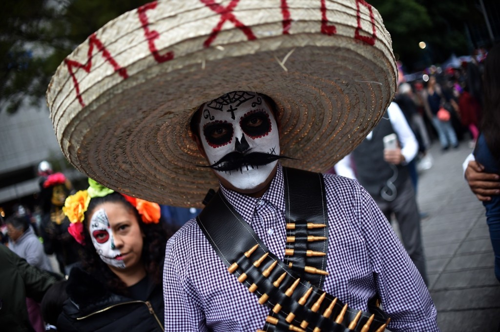 Mexicans get ready to celebrate the Day of the Dead, highlighting the character Catrina, which was created by cartoonist Jose Guadalupe Posada. RODRIGO ARANGUA/AFP/Getty Images