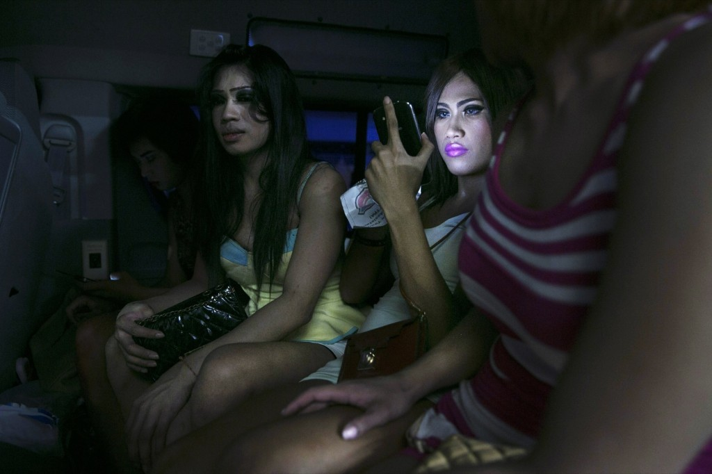Thai ladyboys are detained inside a police van on their way to the police station in Pattaya, Thailand. Paula Bronstein/Getty Images