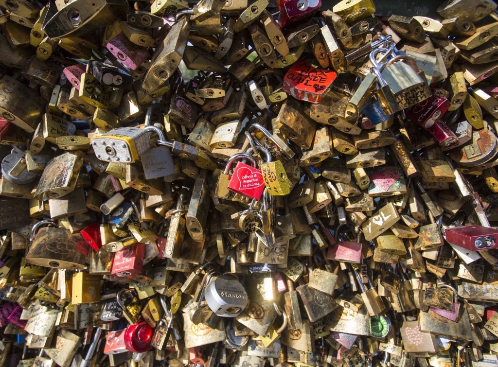 Padlocks are seen hanging on the Pont des Arts bridge, Monday in Paris. The accumulation of 'love locks', where couples attach a lock to symbolize their love on the sides of the bridge posed safety problems, because of their mass weight. Artwork will provisionally be installed on the railings until glass panes have been fitted along the bridge. Geoffroy Van der Hasselt/Anadolu Agency/Getty Images
