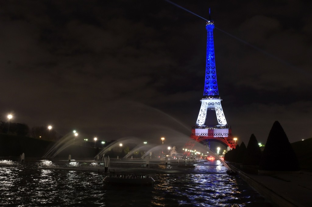 The Eiffel Tower illuminated with the colors of the French flag in tribute to the victims of the November 13, 2015 Paris terror attacks, Monday. ALAIN JOCARD/AFP/Getty Images