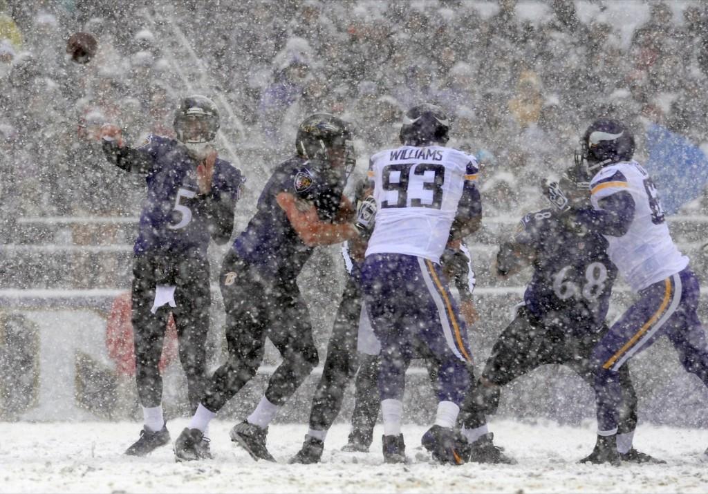 Ravens quarterback Joe Flacco passing through the snow against the Vikings in Baltimore. AP Photo/Gail Burton