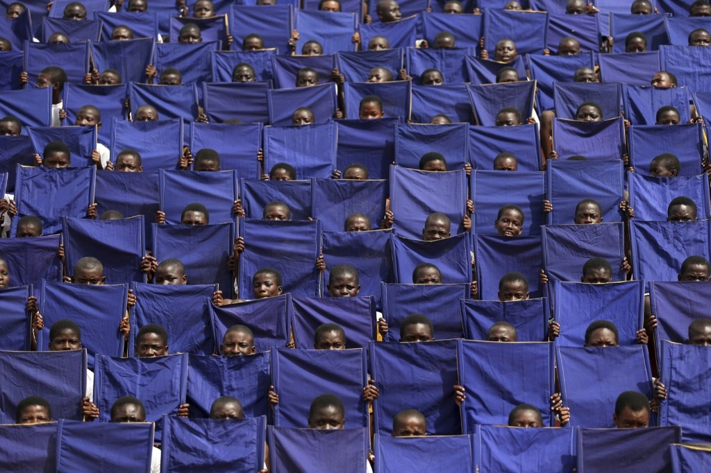 Children during a rehearsal parade in Osogbo, Nigeria, on the eve of Osun state Governor Ogbeni Rauf Aregbesola's inauguration. REUTERS/Akintunde Akinleye