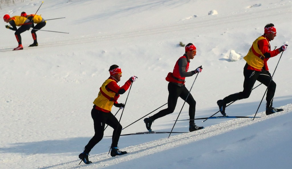 Athletes from Canada train ahead of the men's 50km mass start classic. REUTERS/Carlos Barria