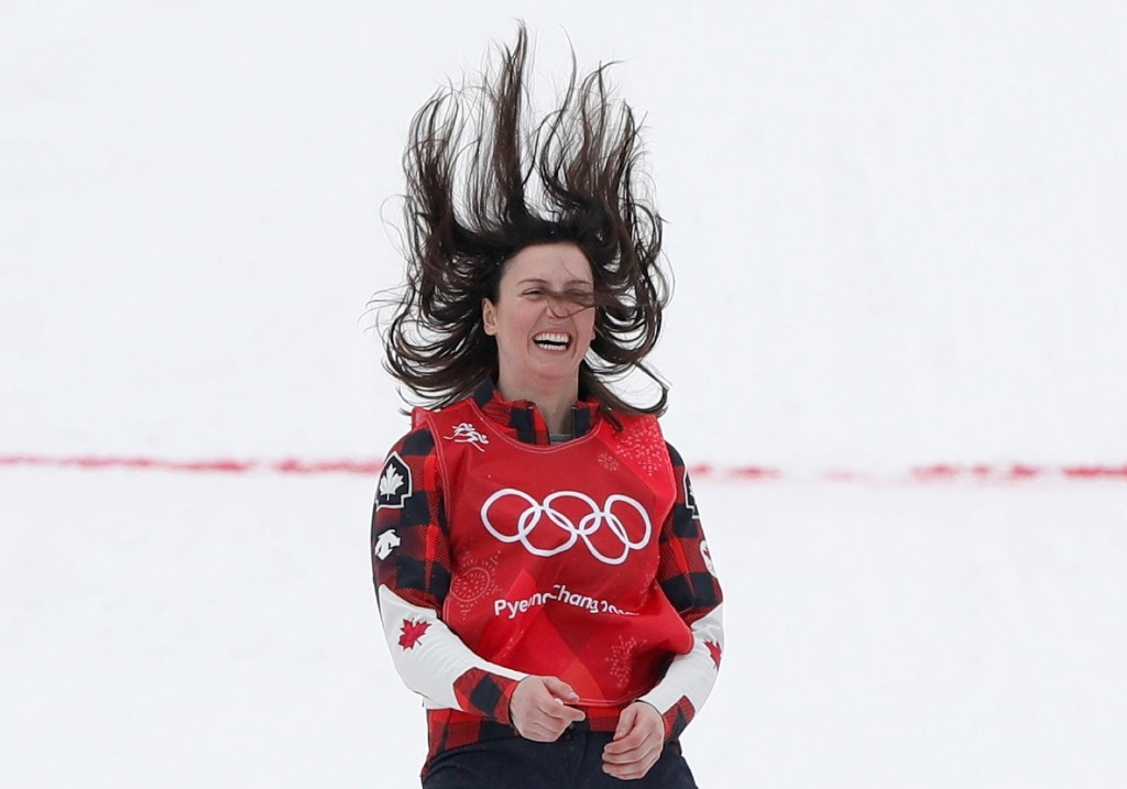 Gold medalist Kelsey Serwa of Canada celebrates during the flower ceremony in women's ski cross. REUTERS/Issei Kato