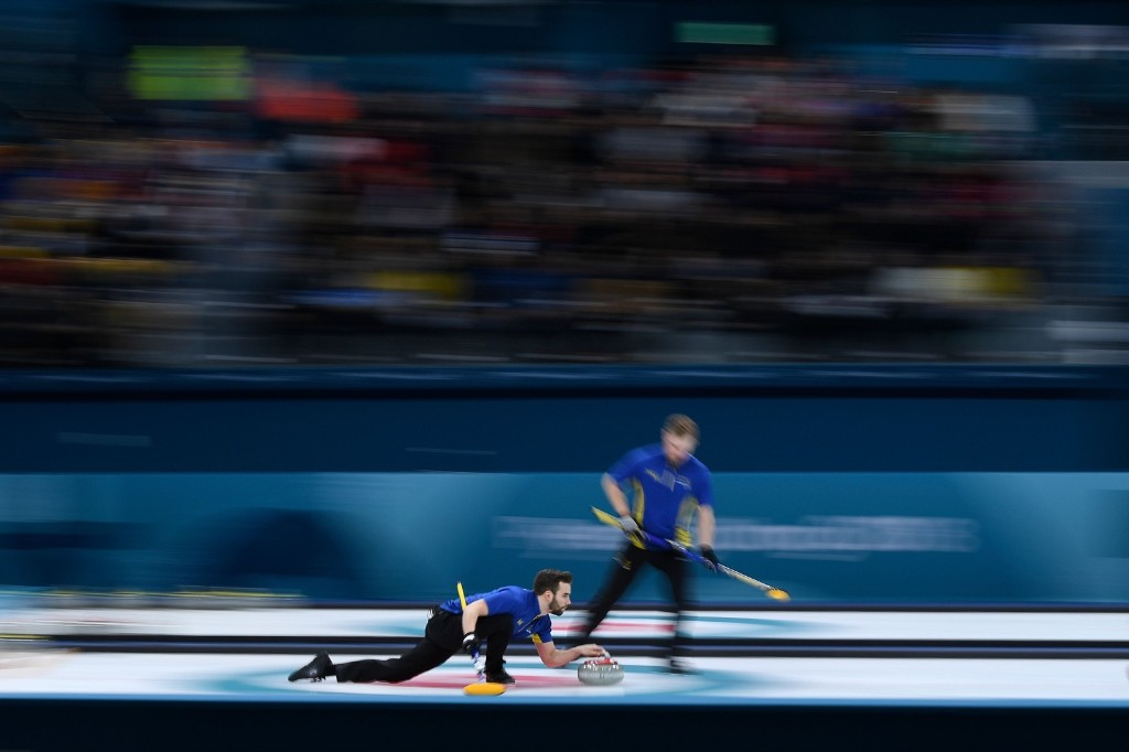 Sweden's Oskar Eriksson throws the stone during the curling men's round robin session against Norway. WANG ZHAO/AFP/Getty Images