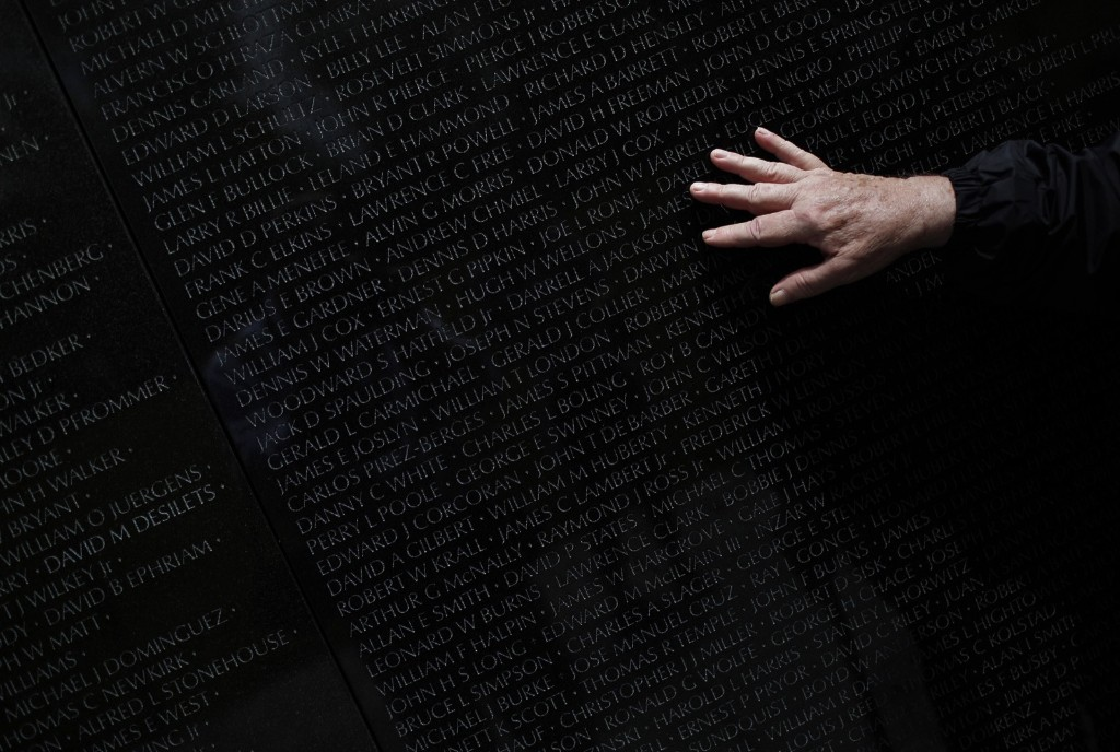 Vietnam war veteran Steve Moczary searches for the name of his friend Msgt. Cecil Hodgson at the Vietnam Veterans Memorial. Win McNamee/Getty Images