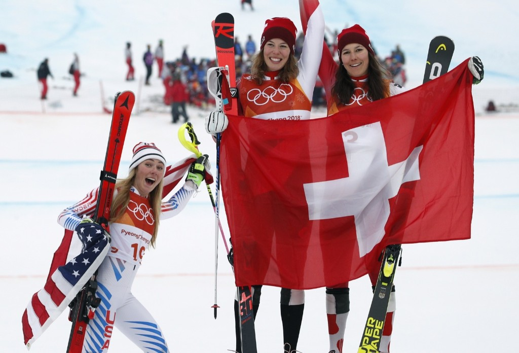 Silver medal winner Mikaela Shiffrin, left, of the U.S. with gold medal winner Michelle Gisin, center, of Switzerland, and bronze medalist Wendy Holdener, also of Switzerland, during the flower ceremony for the women's combined. AP Photo/Christophe Ena