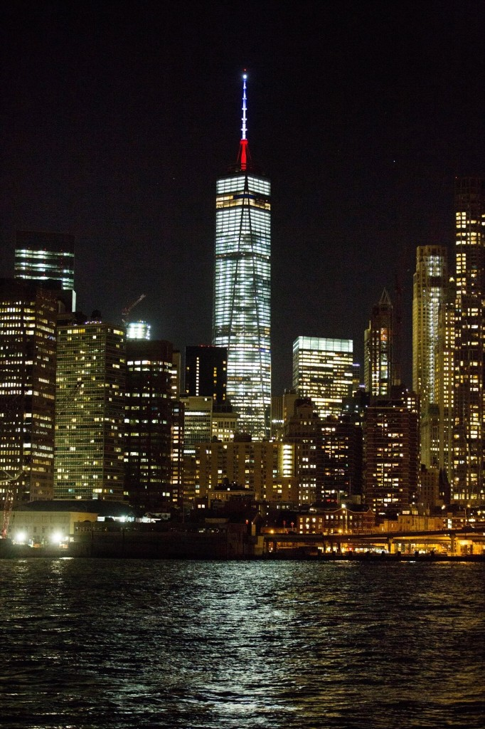 The One World Trade Center spire is lit blue, white and red after the Paris attacks. AP Photo/Kevin Hagen