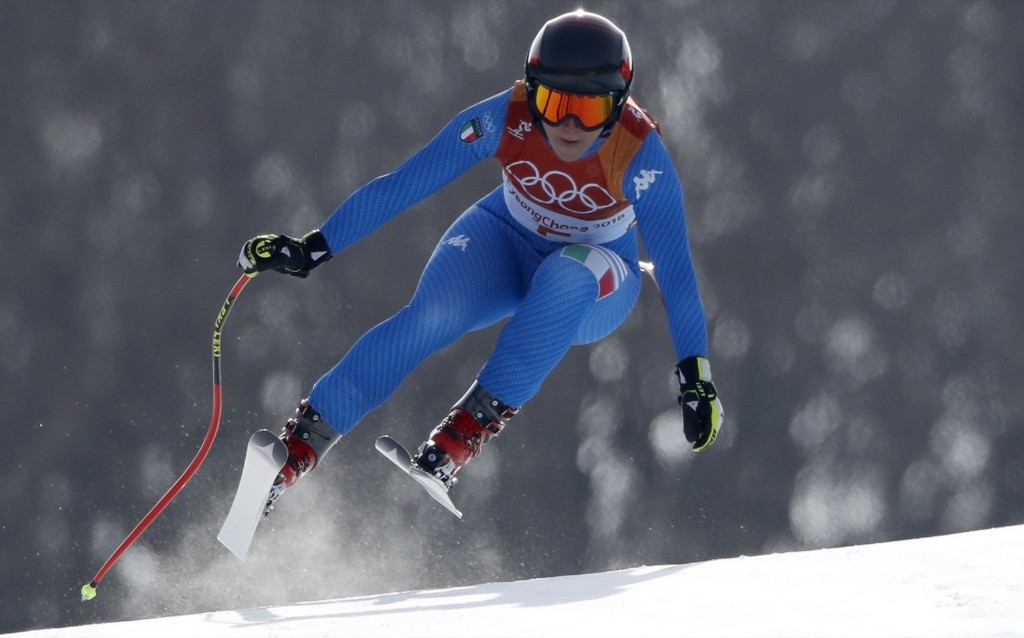 Sofia Goggia of Italy winning the gold medal in women's downhill. REUTERS/Christian Hartmann