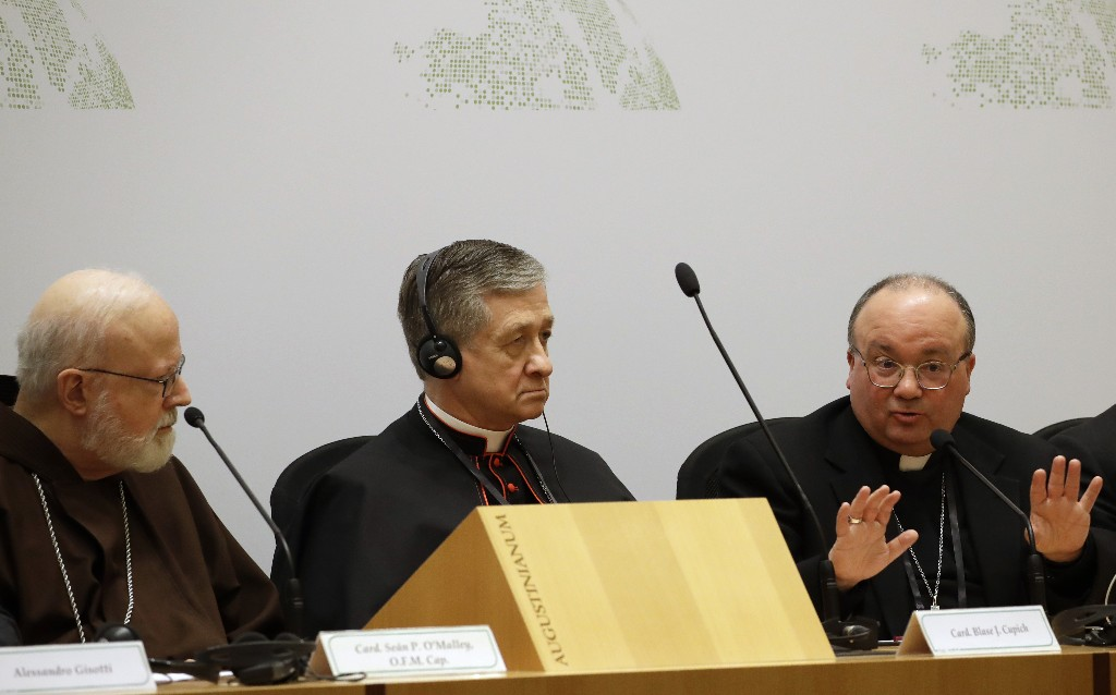 Malta's Archbishop Charles Scicluna, right, answers reporters' questions, flanked by Cardinal Blase J. Cupich, Chicago Archbishop, center, and Cardinal Sean Patrick O'Malley, at a media briefing during a four-day sex abuse summit called by Pope Francis, in Rome, Friday, Feb. 22, 2019. Cardinals attending Pope Francis' summit on preventing clergy sex abuse called Friday for a new culture of accountability in the Catholic Church to punish bishops and religious superiors when they fail to protect their flocks from predator priests. (AP Photo/Alessandra Tarantino)