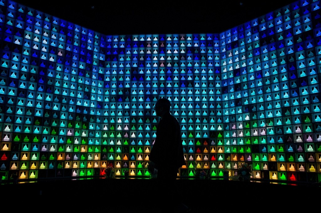 Koukokuji temple priest Yajima Taijun walks through the Ruriden columbarium as glass Buddha alters are lit up in Tokyo. Chris McGrath/Getty Images