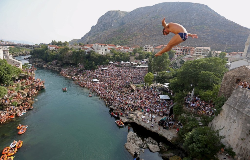 A competitor jumps from the Old Bridge during Red Bull Cliff Diving Competition in Mostar, Bosnia and Herzegovina. REUTERS/Dado Ruvic