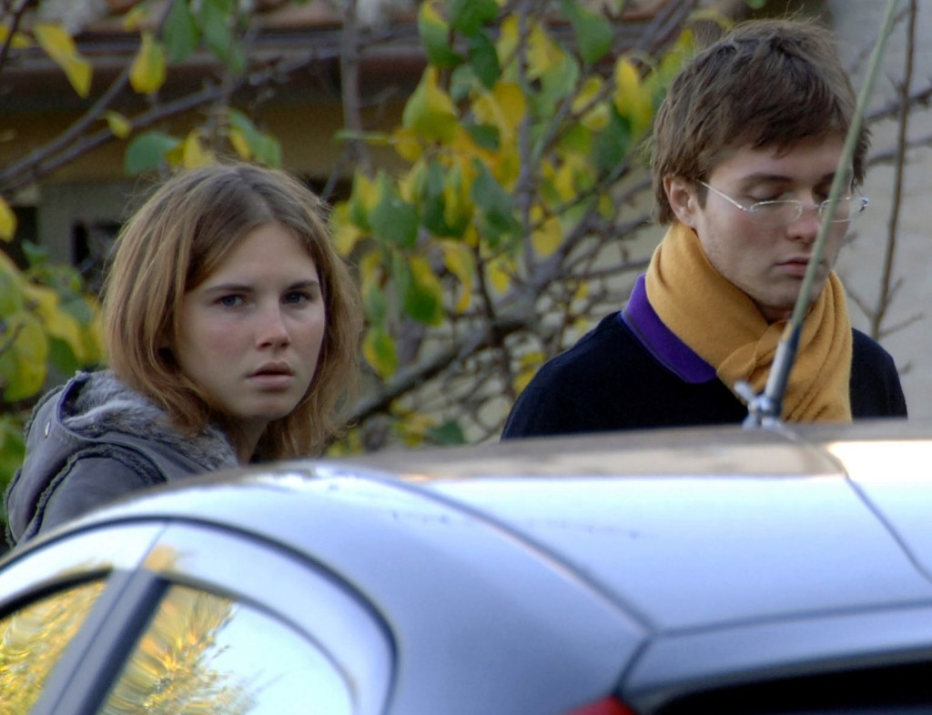 Amanda Knox and Raffaele Sollecito outside the rented house on Nov. 2, 2007 where 21-year-old British student Meredith Kercher was found dead in Perugia, Italy. AP Photo/Stefano Medici