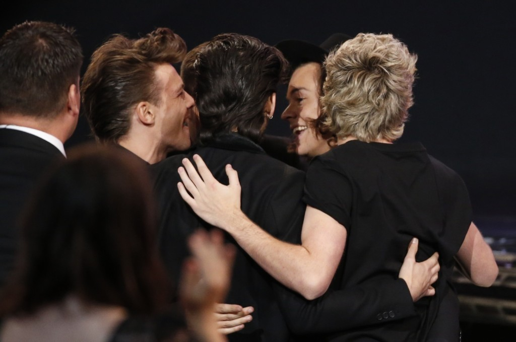 Members of One Direction celebrate as they rise to accept the award for favorite pop/rock band duo or group. REUTERS/Mario Anzuoni