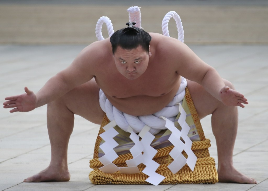 Sumo grand champion Hakuho of Mongolia performs his ring entry forms at the Meiji Shrine in Tokyo. AP Photo/Koji Sasahara
