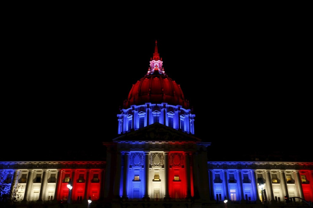 San Francisco City Hall is lit up with blue, white and red, the colors of the French flag. REUTERS/Stephen Lam