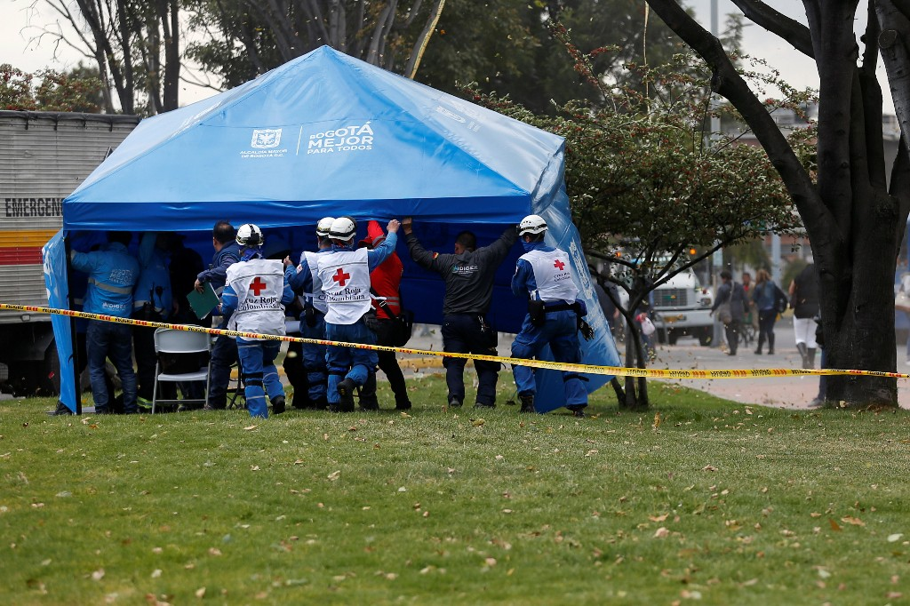 First responders set a tent close to the scene where a car bomb exploded, according to authorities, in Bogota, Colombia January 17, 2019. REUTERS/Luisa Gonzalez