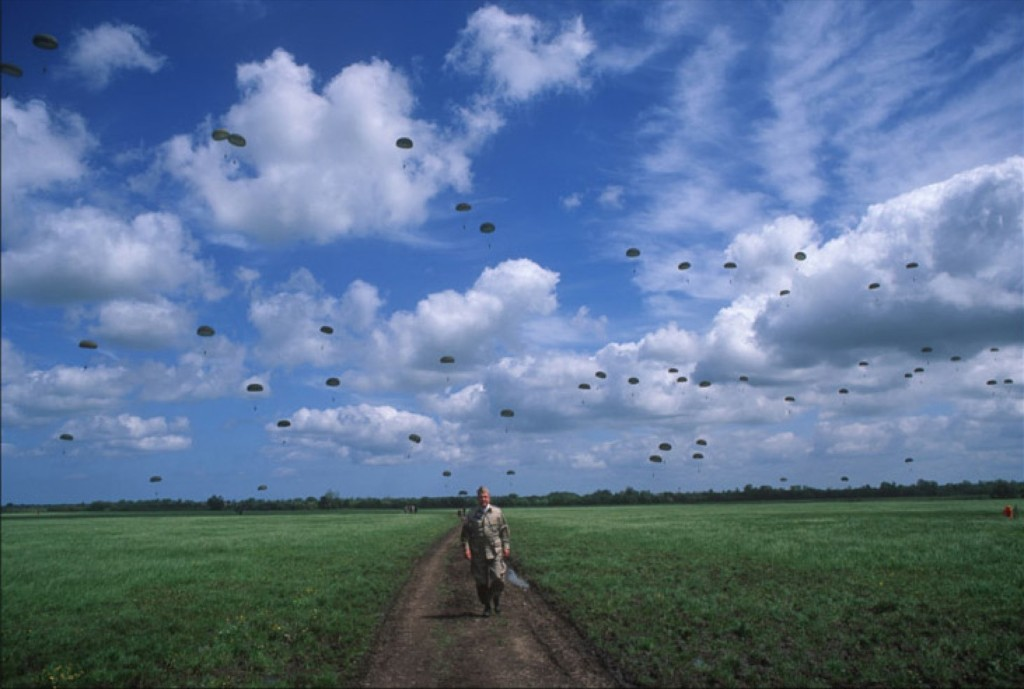 Paratroop veterans jump near Sainte-Mere l'Eglise, during 50th anniversary celebration, 1994. David Burnett/Contact Press Images