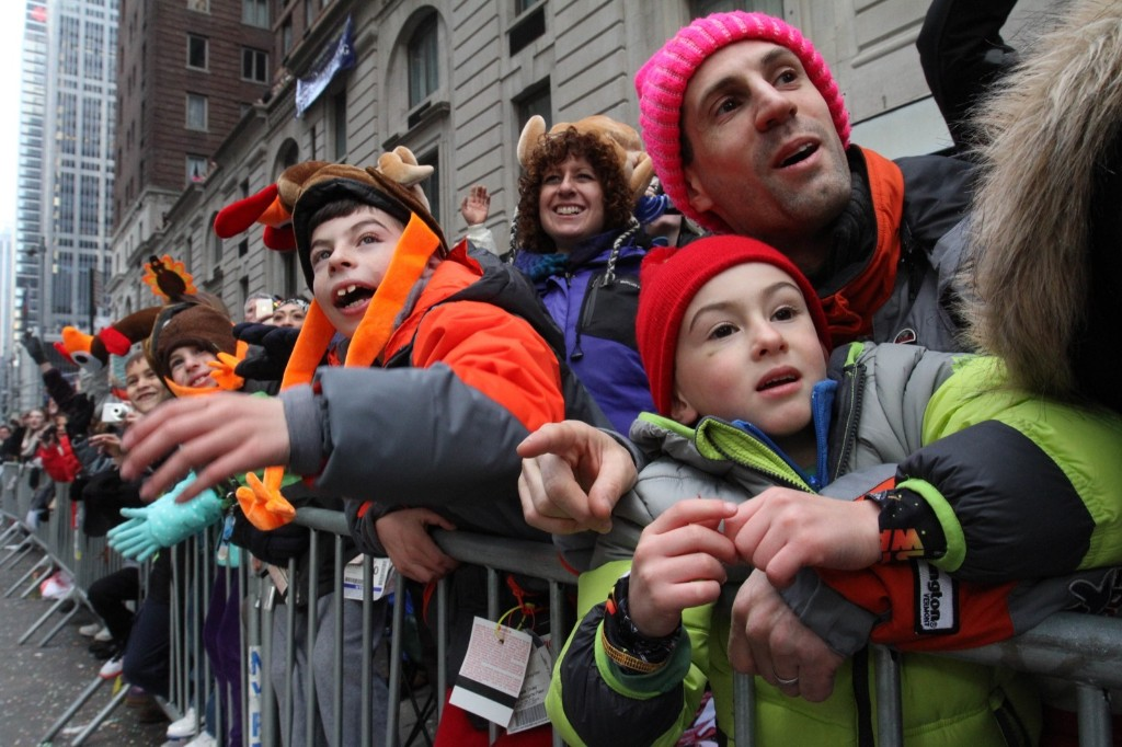 Spectators react as they watch the Macy's Thanksgiving Day Parade make it's way down New York's Sixth Avenue Thursday. AP Photo/Tina Fineberg