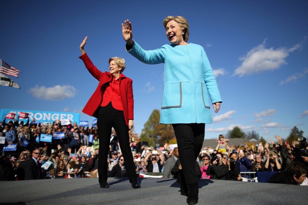 Hillary Clinton with Sen. Elizabeth Warren at Alumni Hall Courtyard, Saint Anselm College in Manchester, N.H. REUTERS/Carlos Barria