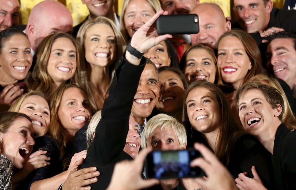 President Obama poses for a selfie taken by Abby Wambach as he welcomes the US Womens National Soccer team to the White House to honor their victory in the 2015 FIFA Womens World Cup. REUTERS/Kevin Lamarque
