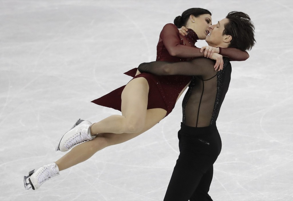 Tessa Virtue and Scott Moir of Canada winning the ice dance competition. AP Photo/Bernat Armangue