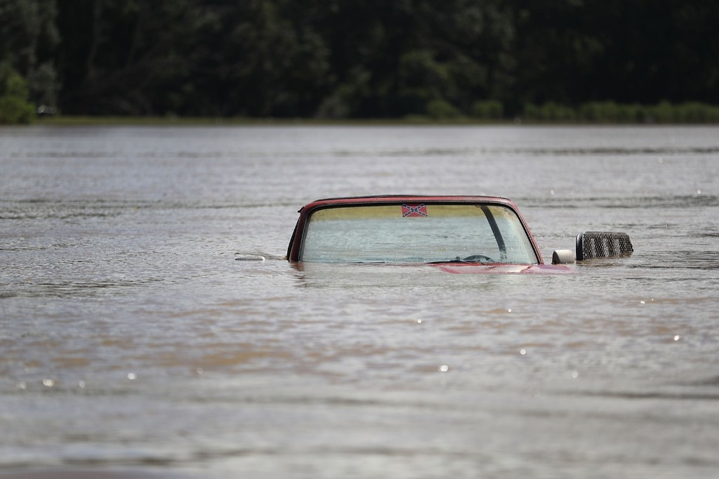 A vehicle partially submerged in Port Vincent, La. Joe Raedle/Getty Images