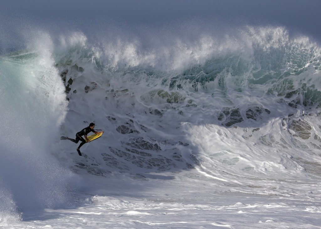 A boogie boarder rides a wave at the wedge in Newport Beach, Calif. AP Photo/Chris Carlson
