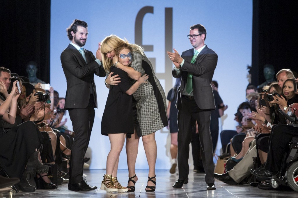 Madeline Stuart, an Australian model with Down Syndrome, is embraced by her mother Rosanne Stuart as Designers Hendrik Vermeulen (L) and JD Meyer-Vermeulen (R) look on. REUTERS/Andrew Kelly