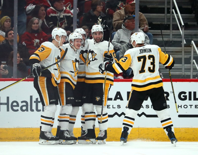 Jan 18, 2019; Glendale, AZ, USA; Pittsburgh Penguins center Jake Guentzel (59) celebrates with teammates after scoring a goal against the Arizona Coyotes in the second period at Gila River Arena. Mandatory Credit: Mark J. Rebilas-USA TODAY Sports