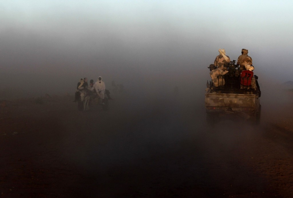 A military convoy of government forces accompanying Special Prosecutor Yasir Ahmed Mohamed and his team moves towards Tabit village in North Darfur. REUTERS/Mohamed Nureldin Abdallah