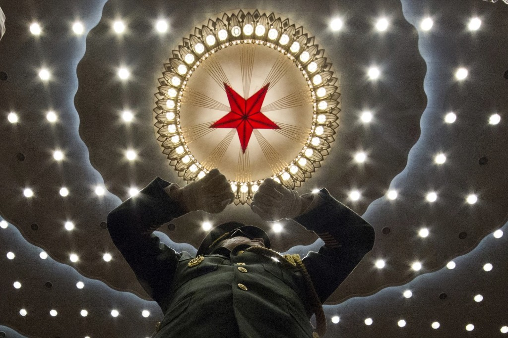 A Chinese military band conductor at the opening session of the annual National People's Congress in Beijing's Great Hall of the People. AP Photo/Ng Han Guan