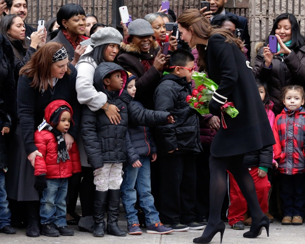 Kate, Duchess of Cambridge greets children outside the Northside Center in New York, Monday. AP Photo/Richard Drew