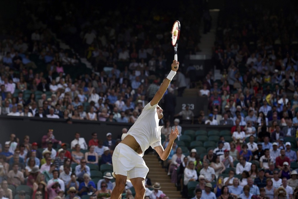 Roger Federer serves during his match against Roberto Bautista Agut. REUTERS/Toby Melville