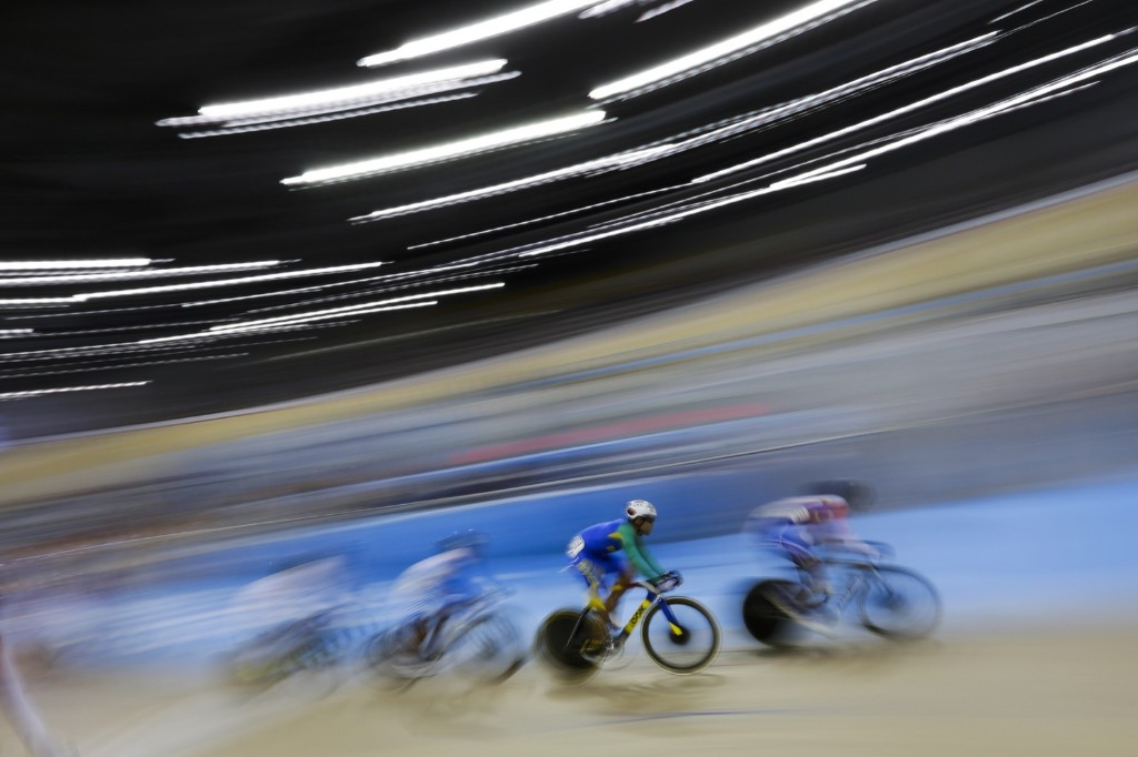 Brazil's Gideoni Monteiro, second right, during the mens omnium track cycling competition at the Pan Am Games. AP Photo/Felipe Dana