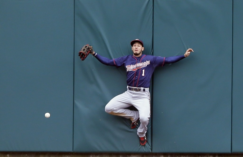 Minnesota Twins center fielder Jordan Schafer misplays a triple hit by the Tigers' Yoenis Cespedes during the sixth inning of opening day in Detroit. AP Photo/Carlos Osorio