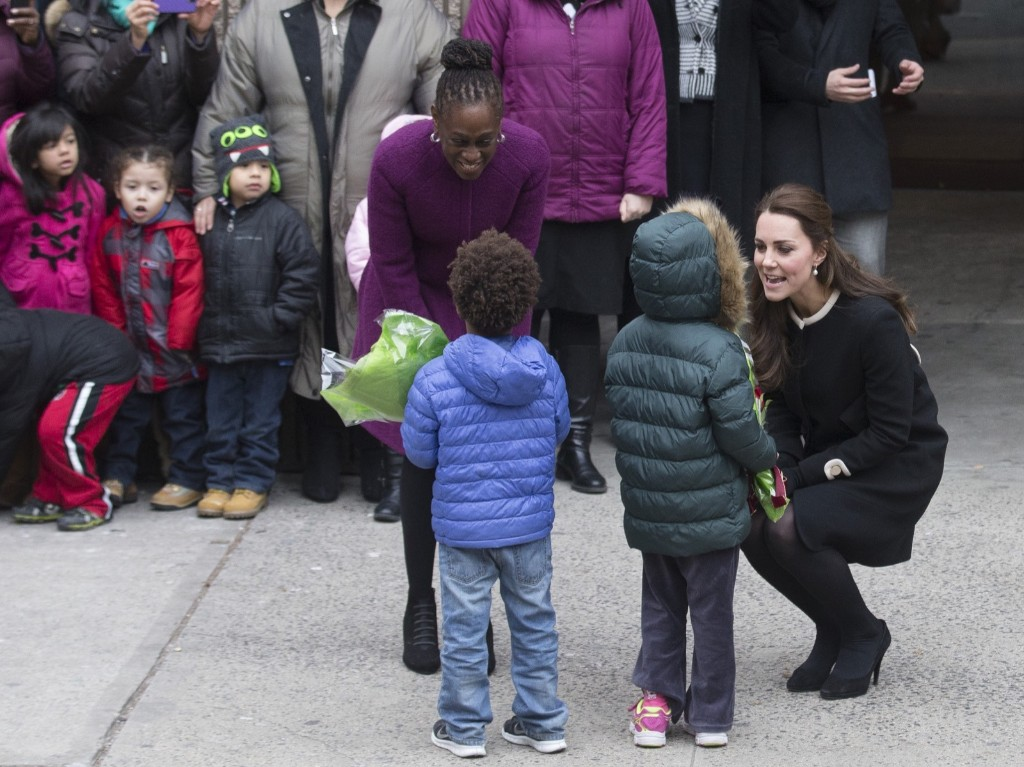 Chirlane McCray, first lady of New York City and Britain's Kate, Duchess of Cambridge outside the Northside Center for Child Development, Monday in New York. AP Photo/John Minchillo