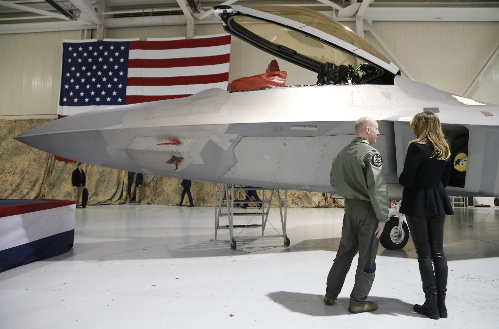 First lady Melania Trump, right, talks with Col. Jason Hinds, Commander of the First Fighter Wing as he shows her the cockpit of an F22 fighter at Joint Base Langley in Hampton, Va., Wednesday, Dec. 12, 2018. (AP Photo/Steve Helber)