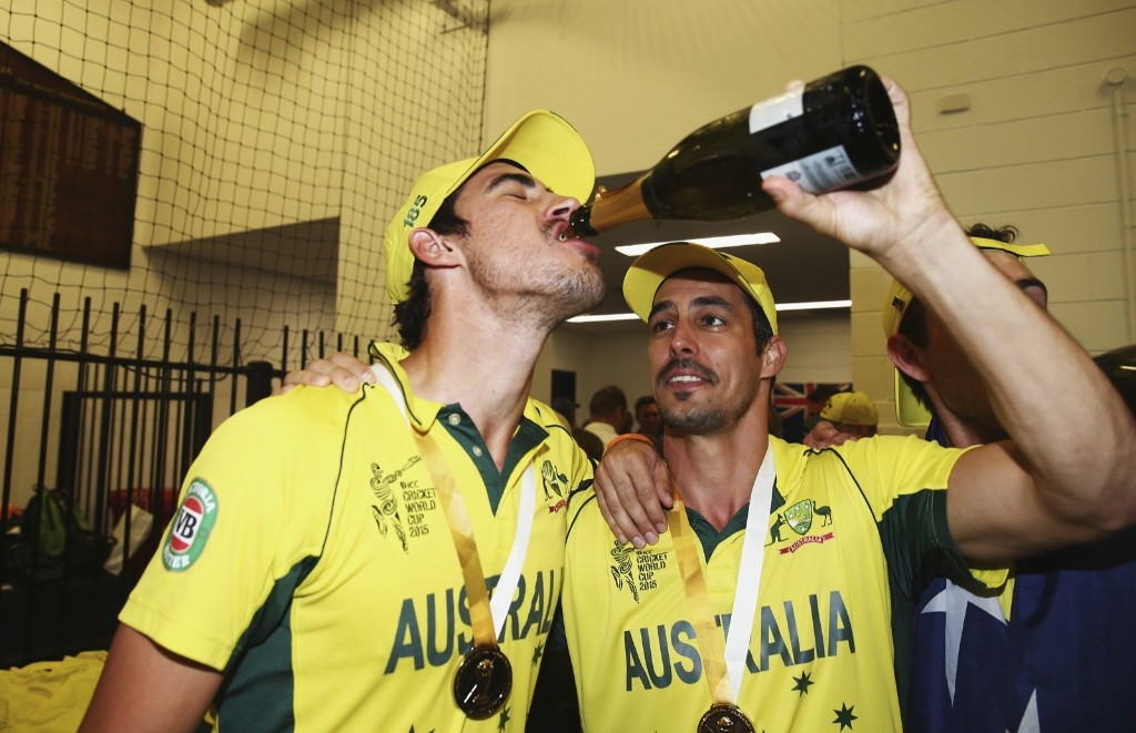 Mitchell Starc and Mitchell Johnson of Australia in the dressing room after winning the 2015 ICC Cricket World Cup final match against New Zealand, Sunday, in Melbourne. Ryan Pierse/Getty Images